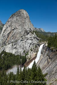 Liberty Cap and Nevada Falls,viewed from the John Muir Trail.  Merced River is in peak spring flow from heavy snow melt in the high country above Yosemite Valley, Yosemite National Park, California