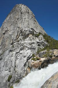 Nevada Falls, with Liberty Cap rising above it. Nevada Falls marks where the Merced River plummets almost 600 through a joint in the Little Yosemite Valley, shooting out from a sheer granite cliff and then down to a boulder pile far below, Yosemite National Park, California