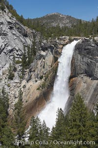 Nevada Falls marks where the Merced River plummets almost 600 through a joint in the Little Yosemite Valley, shooting out from a sheer granite cliff and then down to a boulder pile far below, Yosemite National Park, California