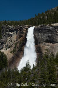 Nevada Falls viewed from the John Muir Trail, Merced River in peak spring flow from heavy snow melt in the high country above Yosemite Valley, Yosemite National Park, California