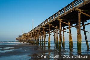 Newport Pier, underneath the pier, pilings and ocean, Newport Beach, California