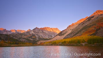 North Lake lit by alpenglow before sunrise, a three frame panorama, with groves of yellow and orange aspen trees on the side of Paiute Peak, Bishop Creek Canyon, Sierra Nevada Mountains