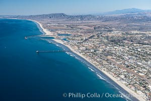 Coastal Oceanside, including Oceanside Pier and Oceanside Harbor, view toward the north showing Camp Pendleton in the distance, aerial photo