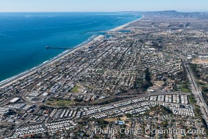 Coastal Oceanside, including Oceanside Pier and Oceanside Harbor, view toward the north showing Camp Pendleton in the distance