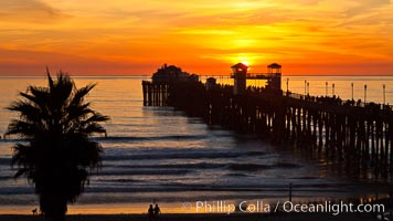 Oceanside Pier at sunset, clouds and palm trees with a brilliant sky at dusk. California, USA, natural history stock photograph, photo id 27609