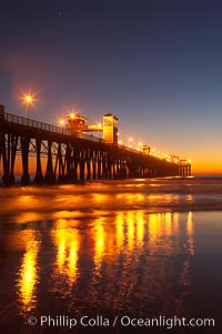 Image 14642, Oceanside Pier at dusk, sunset, night.  Oceanside. California, USA, Phillip Colla, all rights reserved worldwide.   Keywords: beach:california:coast:dock:landmark:ocean:oceanside:oceanside pier:outdoors:outside:pier:pilings:san diego:sea:shore:usa:water:wharf.