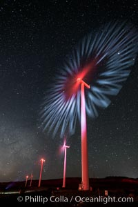 Ocotillo Wind Energy Turbines, at night with stars and the Milky Way in the sky above, the moving turbine blades illuminated by a small flashlight