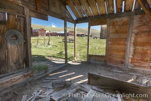 Old barn, interior with Main Street buildings in background, Bodie State Historical Park, California