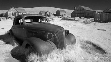 Old car lying in dirt field. Bodie State Historical Park, California, USA, natural history stock photograph, photo id 23112