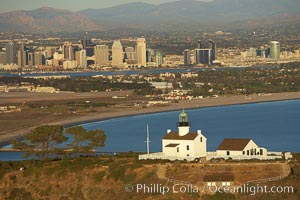 Old Point Loma Lighthouse, sitting high atop the end of Point Loma peninsula, seen here with San Diego Bay and downtown San Diego in the distance.  The old Point Loma lighthouse operated from 1855 to 1891 above the entrance to San Diego Bay. It is now a maintained by the National Park Service and is part of Cabrillo National Monument