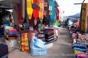 Otavalo market, a large and famous Andean market high in the Ecuadorian mountains, is crowded with locals and tourists each Saturday, San Pablo del Lago