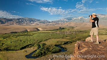 Photographer over Owens River valley, Sierra Nevada mountain range in distance, viewed from Volcanic Tablelands near Bishop, California. Bishop, California, USA, natural history stock photograph, photo id 26985