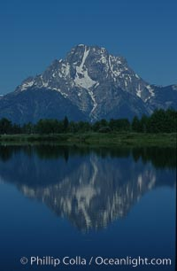 Mount Moran in the Teton Range is reflected in a sidewater of the Snake River at Oxbow Bend, summer. Oxbow Bend, Grand Teton National Park, Wyoming, USA, natural history stock photograph, photo id 07450