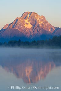 Mount Moran rises above the Snake River at Oxbow Bend at sunrise, Grand Teton National Park, Wyoming