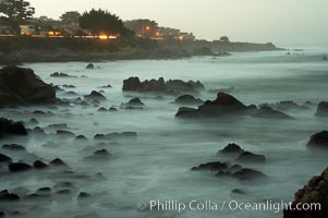 Waves breaking over rocks appear as a foggy mist in this time exposure.  Pacific Grove, Lovers Point