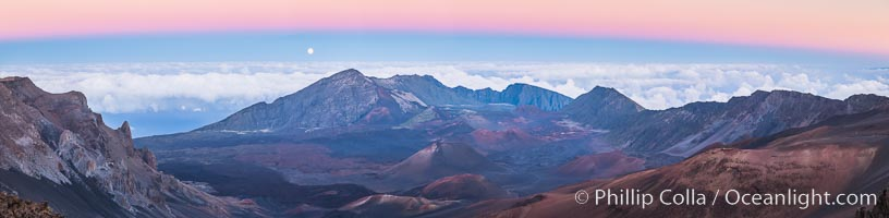 Panorama of Full Moon and Earth Shadow over Haleakala, Maui, Hawaii.  The dark band on the horizon is the shadow of the earth, while the lighter pink band is atmosphere that is still lit by the setting sun