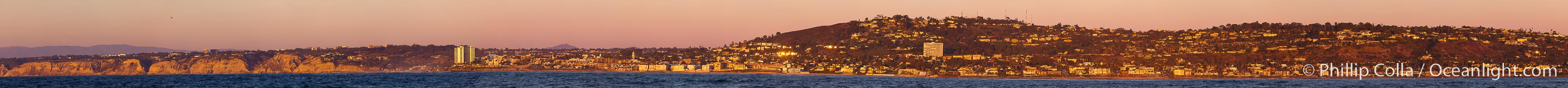 Panorama of La Jolla, with Mount Soledad aglow at sunset, viewed from the Pacific Ocean offshore of San Diego