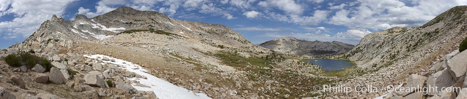 Panorama of Vogelsang basin, surrounding Vogelsang Lake in Yosemite's High Sierra, viewed from near Vogelsang Pass (10685').  Left is Vogelsang Peak (11516'), Choo-choo Ridge is in the distant middle, and the western flank of Fletcher Peak is to the right, Yosemite National Park, California