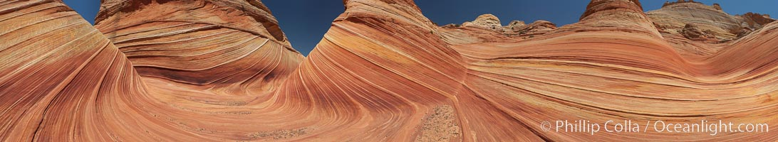 Panorama of the Wave.  The Wave is a sweeping, dramatic display of eroded sandstone, forged by eons of water and wind erosion, laying bare striations formed from compacted sand dunes over millenia.  This panoramic picture is formed from thirteen individual photographs, North Coyote Buttes, Paria Canyon-Vermilion Cliffs Wilderness, Arizona