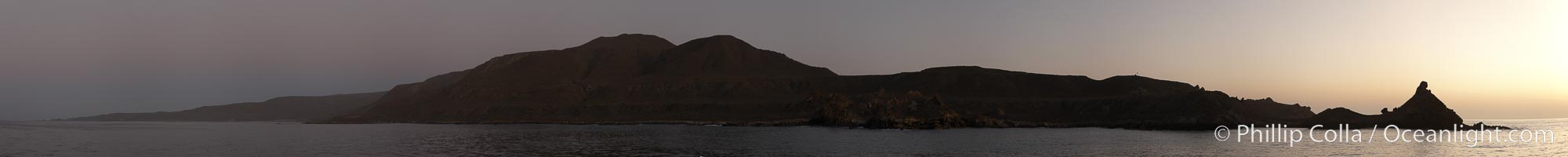 Panoramic photo of San Clemente Island, southern end from China Hat Point (aka, Balanced Rock, right) along the length of Pyramid Cove, sunrise