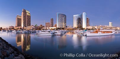 Panoramic photo of San Diego embarcadero, showing the San Diego Marriott Hotel and Marina (center), Roy's Restaurant (center) and Manchester Grand Hyatt Hotel (left) viewed from the San Diego Embarcadero Marine Park