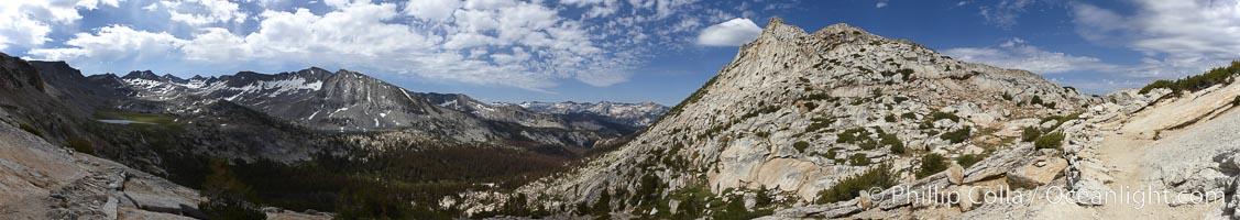 Panoramic view from Vogelsang Pass (10685') in Yosemite's high country, looking south. Visible on the left are Parson's Peak (12147'), Gallison Lake and Bernice Lake in the Cathedral Range, the Clark Range is in the distant middle, while Vogelsang Peak (11516') rises to the right, Yosemite National Park, California