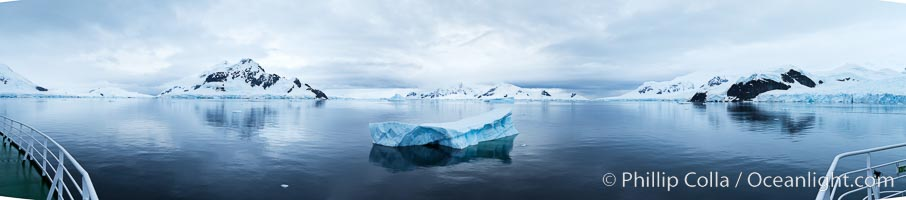 Iceberg and mountain panorama, cloudy morning, Paradise Bay