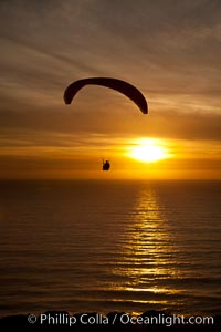 Paraglider soaring at Torrey Pines Gliderport, sunset, flying over the Pacific Ocean. La Jolla, California, USA, natural history stock photograph, photo id 24297