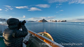Photographer making pictures as M/V Polar Star approaches Devil Island