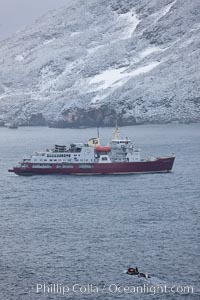 Image 24712, M/V Polar Star at anchor in a snowstorm. Cooper Bay, South Georgia Island, Phillip Colla, all rights reserved worldwide. Keywords: atlantic, boat, cooper bay, icebreaker, oceans, polar star, ship, south georgia island, united kingdom.