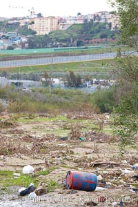 Pollution accumulates in the Tijuana River Valley following winter storms which flush the trash from Tijuana in Mexico across the border into the United States, Imperial Beach, San Diego, California
