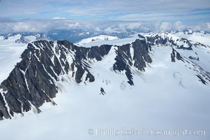 The Kenai Mountains rise above thick ice sheets and the Harding Icefield which is one of the largest icefields in Alaska and gives rise to over 30 glaciers. Kenai Fjords National Park, Alaska, USA, natural history stock photograph, photo id 19026
