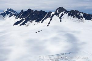 The Kenai Mountains rise above thick ice sheets and the Harding Icefield which is one of the largest icefields in Alaska and gives rise to over 30 glaciers. Kenai Fjords National Park, USA, natural history stock photograph, photo id 19045