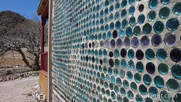 "The strange ""bottle house"" of Rhyolite ghost town, near Death Valley. It was built in 1906 by Tom Kelley of approximately 50,000 beer bottles and was his home for a while. Rhyolite, Nevada, USA, natural history stock photograph, photo id 20589"