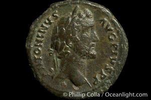 Roman emperor Antonius Pius (138-161 A.D.), depicted on ancient Roman coin (bronze, denom/type: As) (As. Obverse: ANTONIUS AVG PIUS PP. Reverse: TR POT COS II SC PAX (exergue). PAX stg left, holding branch and cornucopiae.)
