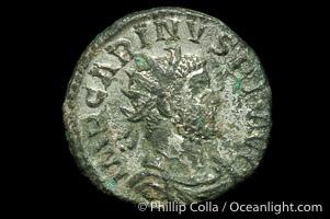 Roman emperor Carinus (283-284 A.D.), depicted on ancient Roman coin (bronze, denom/type: Antoninianus) (Antoninianus VF/aVF; Sear 3474, VanMeter 20.2, Vagi 2492. Reverse: VICTORIA AVGG)