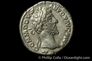 Roman emperor Commodus (177-192 A.D.), depicted on ancient Roman coin (silver, denom/type: Denarius) (AR , Denarius Obverse: M.COMMODVS.ANTON.AVG.PIVS. Reverse: PM.TR.P.VIIII.IMP.VI.COS.IIII.PP. Providentia standing left holding scepter and using baton to point to globe.)