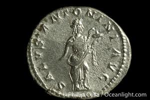 Roman emperor Elegabalus (218-222 A.D.), depicted on ancient Roman coin (silver, denom/type: Antoninianus) (Antoninianus Obverse: IMP.CAES.M.AVR.ANTONINUS.AVG. Reverse: SALUS.ANTONINI.AVG. salus standing half right, holding snake across body and feeding it.)