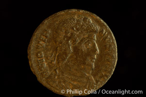 Roman emperor Jovian (363-364 A.D.), depicted on ancient Roman coin (bronze, denom/type: AE3) (AE3. nVF. Reverse: legend in wreath VOT V MVLT X.3.)., natural history stock photograph, photo id 06718