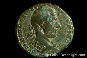 Roman emperor Macrinus (217-218 A.D.), depicted on ancient Roman coin (bronze, denom/type: AE27) (AE 27 of Nicopolis in Moesia, under Legate Statius Longinus; F+. Obverse: Laureated, draped, cuirassed bust right. Reverse: Apollo standing left, holds branch.)