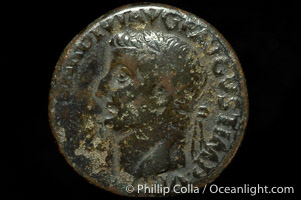 Roman emperor Tiberius (14-37 A.D.), depicted on ancient Roman coin (bronze, denom/type: As) (As, F; Winged caduceus.)