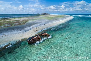 Rusting shipwreck on the beach at Clipperton Island, aerial photo, Clipperton Island is a spectacular coral atoll in the eastern Pacific. By permit HC / 1485 / CAB (France)