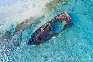 Rusting shipwreck on the beach at Clipperton Island, aerial photo, Clipperton Island is a spectacular coral atoll in the eastern Pacific. By permit HC / 1485 / CAB (France)., natural history stock photograph, photo id 32839