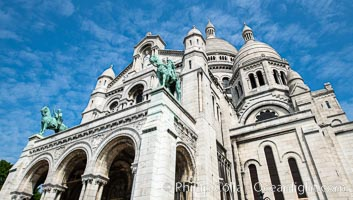Sacre-Coeur Basilica. The Basilica of the Sacred Heart of Paris, commonly known as Sacre-Coeur Basilica, is a Roman Catholic church and minor basilica, dedicated to the Sacred Heart of Jesus, in Paris, France. A popular landmark, the basilica is located at the summit of the butte Montmartre, the highest point in the city, Sacr�-C�ur