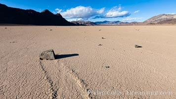 Sailing stone on the Racetrack Playa. The sliding rocks, or sailing stones, move across the mud flats of the Racetrack Playa, leaving trails behind in the mud. The explanation for their movement is not known with certainty, but many believe wind pushes the rocks over wet and perhaps icy mud in winter, Death Valley National Park, California