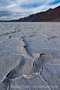 Image 27631, Salt polygons. After winter flooding, the salt on the Badwater Basin playa dries into geometric polygonal shapes. Badwater, Death Valley National Park, California, USA, Phillip Colla, all rights reserved worldwide. Keywords: arid, badwater, california, death valley, death valley national park, desert, dry, environment, harsh, landscape, national parks, nature, outdoor, outdoors, outside, playa, polygon, salt, salt polygon, scene, scenery, scenic, usa.