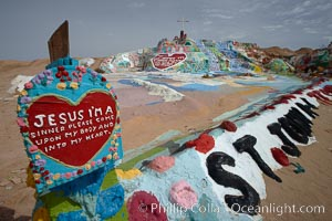 """Salvation Mountain, near the desert community of Slab City and the small town of Niland on the east side of the Salton Sea.  Built over several decades by full-time resident Leonard Knight, who lives at the site, Salvation Mountain was built from over 100,000 gallons of paint, haybales, wood and metal and was created by Mr. Knight to convey the message that """"God Loves Everyone"""". California, USA, natural history stock photograph, photo id 22507"""