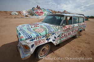 Image 22508, Salvation Mountain, near the desert community of Slab City and the small town of Niland on the east side of the Salton Sea.  Built over several decades by full-time resident Leonard Knight, who lives at the site, Salvation Mountain was built from over 100,000 gallons of paint, haybales, wood and metal and was created by Mr. Knight to convey the message that