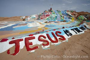 Image 22513, Salvation Mountain, near the desert community of Slab City and the small town of Niland on the east side of the Salton Sea.  Built over several decades by full-time resident Leonard Knight, who lives at the site, Salvation Mountain was built from over 100,000 gallons of paint, haybales, wood and metal and was created by Mr. Knight to convey the message that