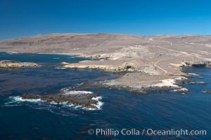 San Clemente Island, rugged barren coastline and island terrain surrounded by lush underwater kelp forests and marine life